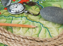 Topographic maps. And pocket watches Stock Photo