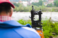 Topographic measurements. Using a theodolite instrument Royalty Free Stock Images