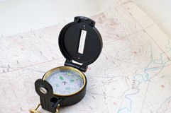 Topographical map and compass Stock Images