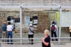 Topography of Terror, Berlin. The visitors are listening to guide tour in Topography of Terror, Berlin royalty free stock photos