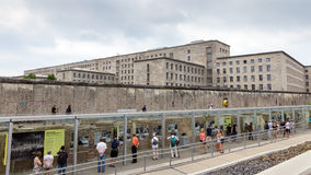 Topography of Terror Documentation Center. BERLIN - MAY 23, 2014: View on a part of the Berlin Wall and German Finance Ministry at the Topography of Terror royalty free stock photos