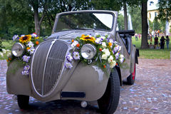 Topolino. Italian historian convertible car decorated with flowers Royalty Free Stock Images