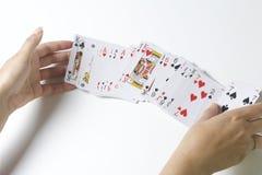 topp- modig lycka för kort fyra En kvinna hasar en kortlek På en vit bakgrund Royaltyfri Fotografi