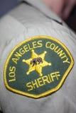 Toppa di spalla del dipartimento dello sceriffo della contea di Los Angeles immagini stock