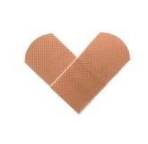 Toppa medica come simbolo del cuore isolata su bianco Immagine Stock Libera da Diritti