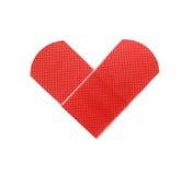 Toppa medica come simbolo del cuore isolata su bianco Fotografia Stock