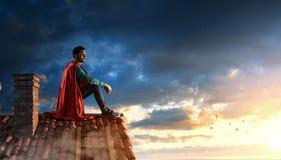 Toppen hjälte på taket Blandat massmedia arkivbild