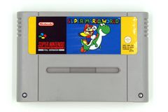 Toppen modig kassett för Nintendo underhållningsystem SNES av toppna Mario World royaltyfri bild