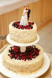 Topper on a wedding cake. A wedding cake topper on top of the newlyweds dessert royalty free stock photography