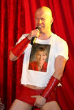 Topping and Butch Comedy. Butch of Comedy Act, Topping and Butch, holding his crutch and wearing a Sarah Palin T-shirt performing their musical satire show in Stock Photography