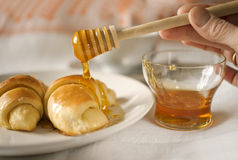 Topping off with honey Stock Photography