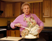 Topping the Pie. Expressive senior woman putting topping on her no-bake pie Royalty Free Stock Photos