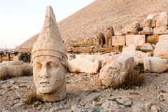 Toppled heads of the gods on East terrace at the top of Nemrut d Royalty Free Stock Photos