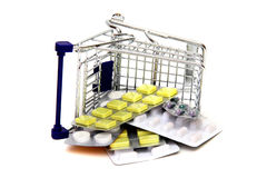 Toppled shoppingcart with medicines Royalty Free Stock Images