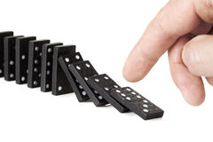 Toppling a row of domino pieces Royalty Free Stock Photos