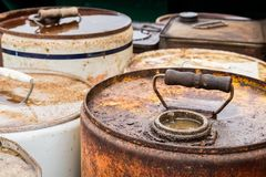 Old Tin Containers. Tops areas of some old chemicals containers with handles royalty free stock image