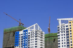 Tops of buildings with tower cranes (close up) Stock Image