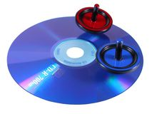 Tops on the CD. Concept for moving data-spin tops moving on a CD Stock Image