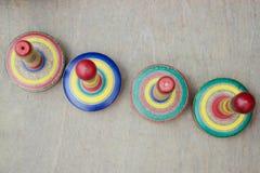 Tops de madera coloridos Fotografía de archivo