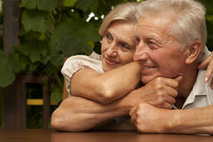 Tops elderly couple sitting on the veranda Stock Image
