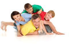 Tops family in bright T-shirts Royalty Free Stock Images