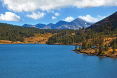The tops of mountains and azure lake Stock Image