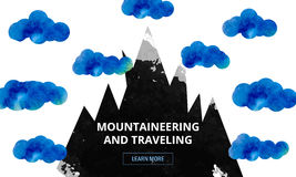The tops of the mountains in the clouds. Advertising a ski holiday in the mountains. A scene of nature in mountainous Stock Photos