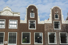 Tops of old brown buildings in Amsterdam Stock Images