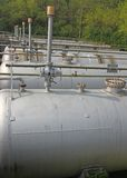 Tops of the tanks with exhaust valves for storage of natural gas Royalty Free Stock Image