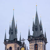 The tops of two towers of Church of Our Lady in Prague Stock Image