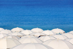 Tops of white and blue parasols Stock Photos