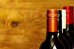 Tops of wine bottles with screw caps. For background Royalty Free Stock Photo