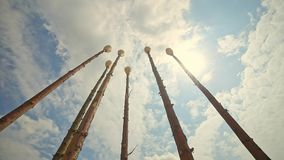 Tops of the Wooden Objects on a Background of Blue Sky Huge Matches stock video footage