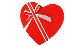 Topside of a heart shaped gift box with a ribbon. On a white background Stock Photography
