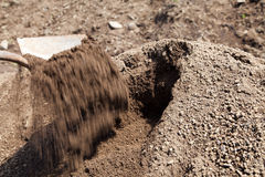 Topsoil being turned with a spade royalty free stock photo