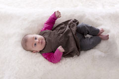 Topview of baby lying on a carpet Royalty Free Stock Images