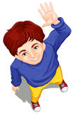 A topview of a boy waving while facing the sky Stock Photos