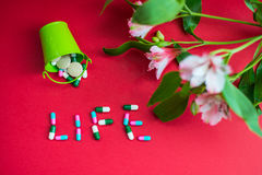 Topview at the caption life with the pills Royalty Free Stock Image