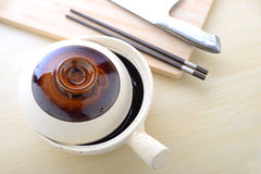 Topview of chinese clay pot with chopsticks Royalty Free Stock Photo