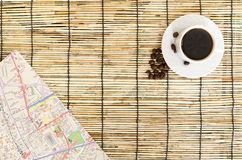 Topview of Coffee beans with paper map on mat Royalty Free Stock Photo