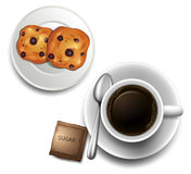 A topview of a cup of coffee and a plate of cookies Royalty Free Stock Image