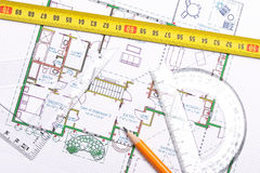 Topview of floor plan. Top view of a tape measure, pencil and other tools on top of floor plan stock photography