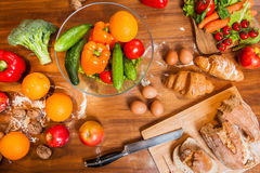 Topview of Fruits and vegetables on wooden kitchen table Royalty Free Stock Image