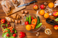 Topview of Fruits and vegetables on wooden kitchen table Stock Photos