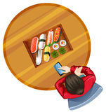 A topview of a girl at the table with sushi Stock Photography