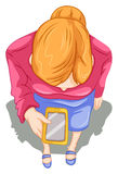 A topview of a girl using a cellphone Stock Images