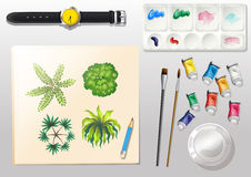 A topview of the materials for painting and a watch Stock Images