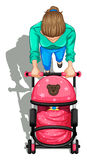 A topview of a mother pushing a stroller with a baby