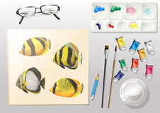 A topview of a painting and the different painting materials Stock Photo