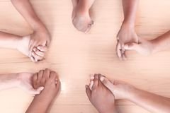 Topview of parent and children holding hands and praying Royalty Free Stock Photos